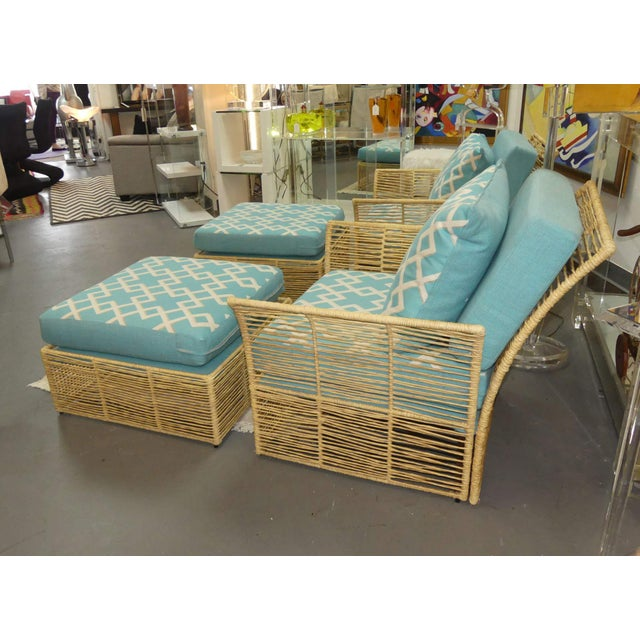 A fantastic pair of lounge chairs and ottomans. Natural raffia is twisted and laced to form the frame. Features out swept...