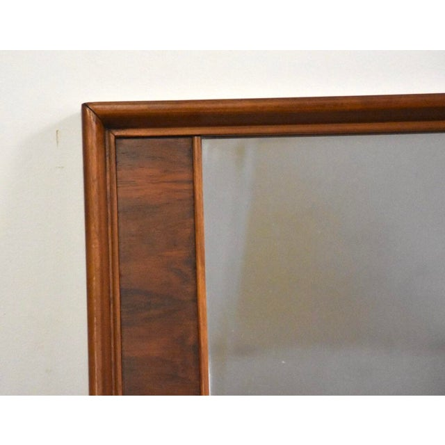 A mid century modern walnut and rosewood mirror made by Kent Coffey Perspecta