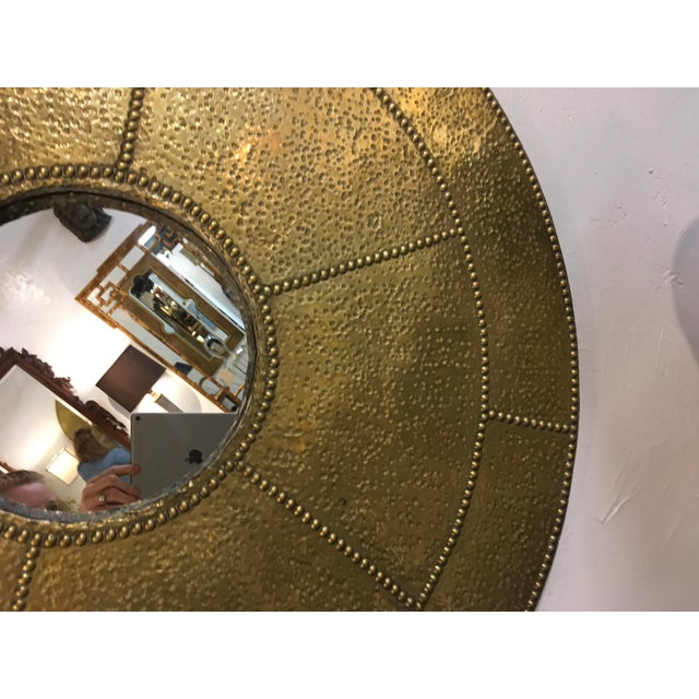 Very cool, hammered brass circular mirror by Sarreid. I believe this was a tabletop, I repurposed , by adding the mirror....
