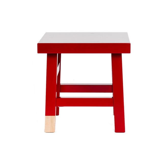 Common Comrade Side Table By Moooi. This red lacquered solid birch side table from Moooi is a clever personification of...