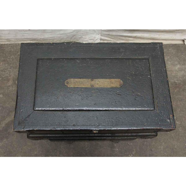 Wooden box with lots of vintage details such as decorative iron straps, a signed bronze tag and iron handles. It has a...