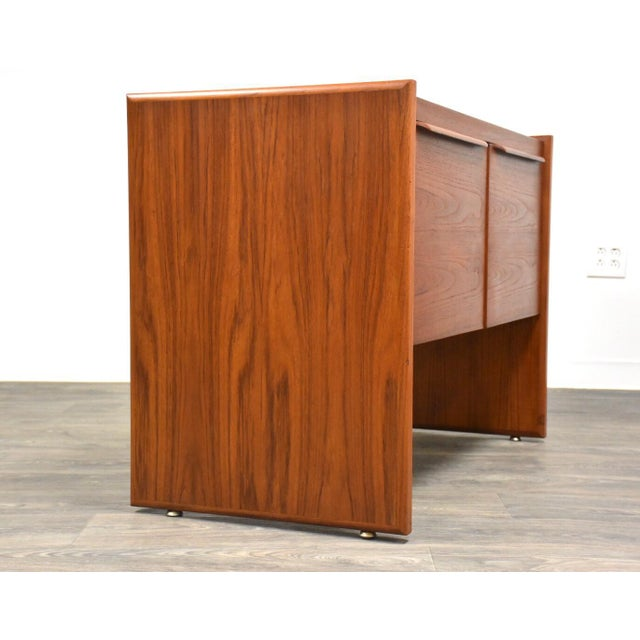 A mid century modern teak filing cabinet with a finished back perfect for your work or home office! Made in Denmark....