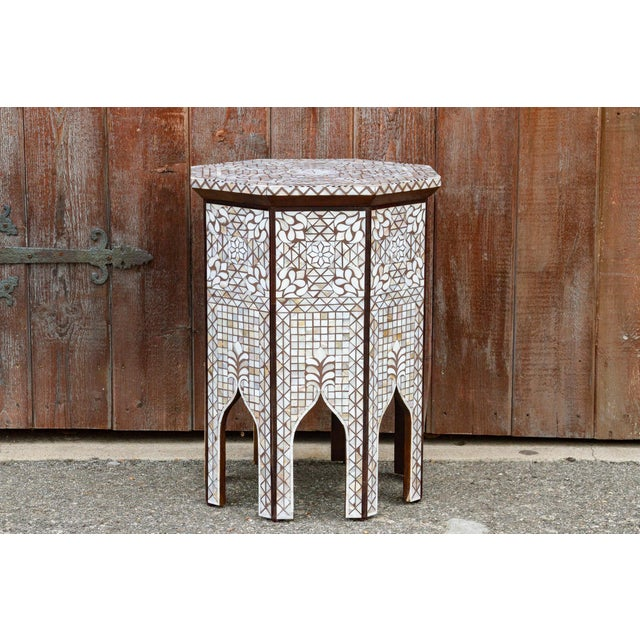 Beautiful Inlaid table of octagonal shape constructed from hardwood and intricately inlaid with mother of pearl pieces in...