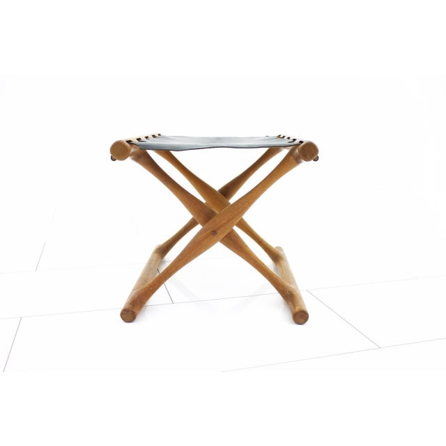 Folding stool by Poul Hundevad, PH 43. Solid teak and black leather. Made in Denmark, circa, 1950s. Very good condition...