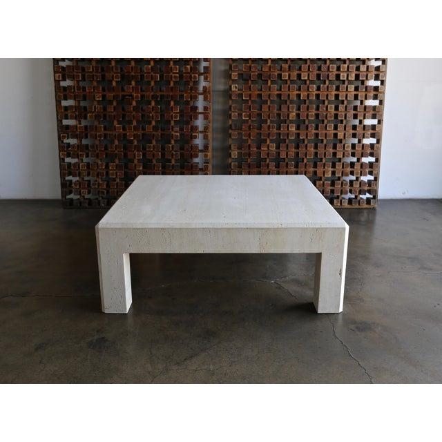 Square travertine coffee table, circa 1980.