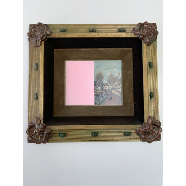 A vintage framed original oil painting has been modernized with color blocking paint. This ornate frame finishes off this...
