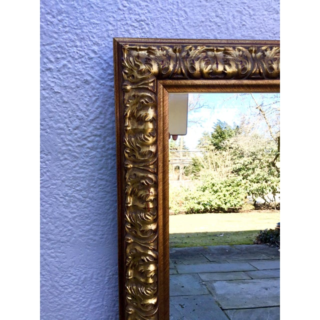 Good quality gilt mirror. Can be hung vertically or horizontally. Made of wood and plaster. Substantial, ornately designed...