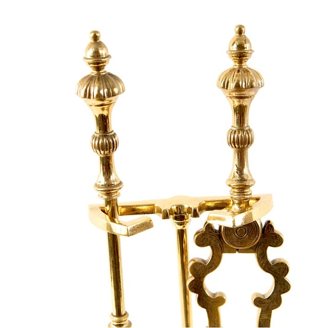 Solid brass fireplace tool set consisting of stand, shovel, and thongs. All are high quality with elegant detailing...