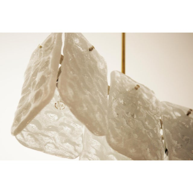 This bronze, steel and frosted glass chandelier was designed during the 1960s by JT Kalmar. It features three E27 sockets...