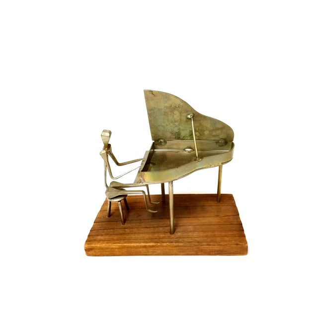 Modern Metal Pianist Playing Piano Design with Horse Nail Sculpture Made in Spain Item Details: -Handmade in Spain -From...