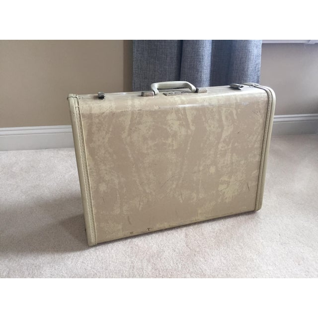 Travel in style with this Vintage (circa 1950's) royal traveller brand suitcase. Beige outside color, avocado interior...