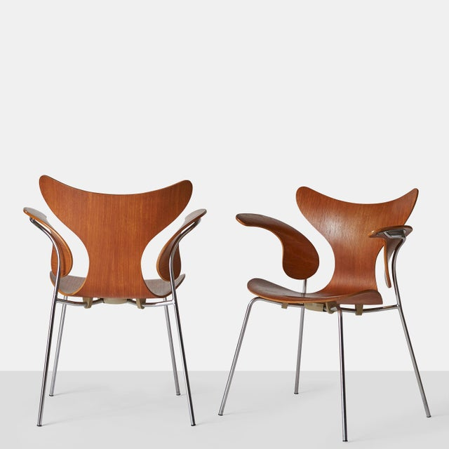 Armchair with teak shell and armrests, chromed tubular steel base. Designed in 1970. Produced by Fritz Hansen, year 1970....