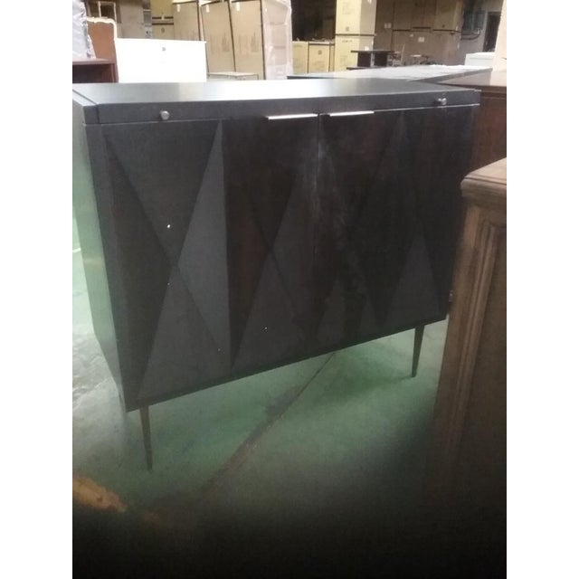 Brand new bar cabinet currently available on the manufacturer's retail site. Beautiful dark wood cabinet with mirrored...