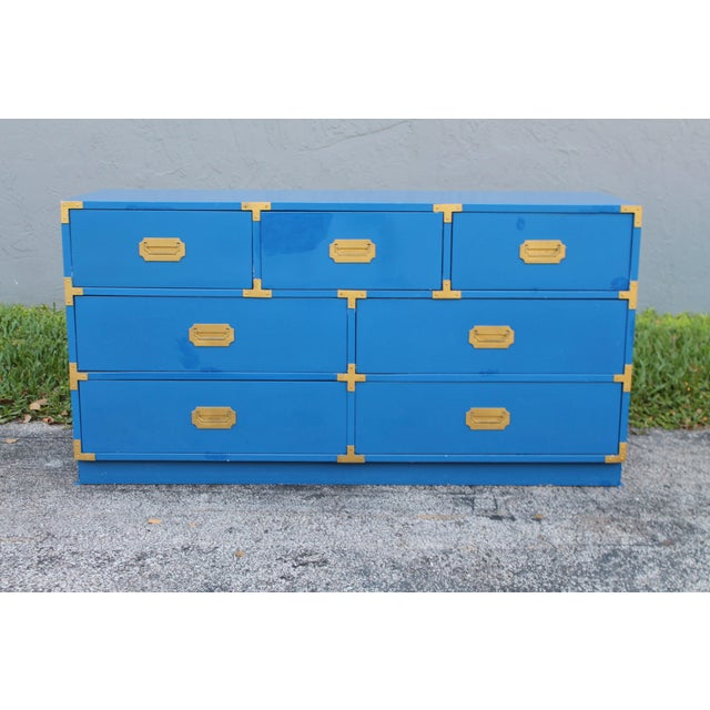A beautiful Mid Century Campaign Dresser. This dresser features 7 drawers and a Bernhardt makers stamp on the inside of...