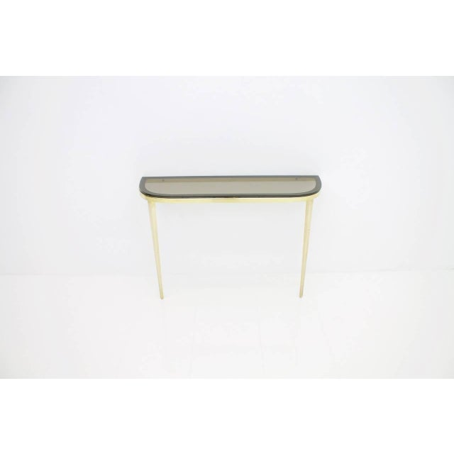 Wall-mounted console in solid brass and glass top, Germany, 1960s. Measures: W 90 cm, H 60 cm, D 26 cm Very good condition.