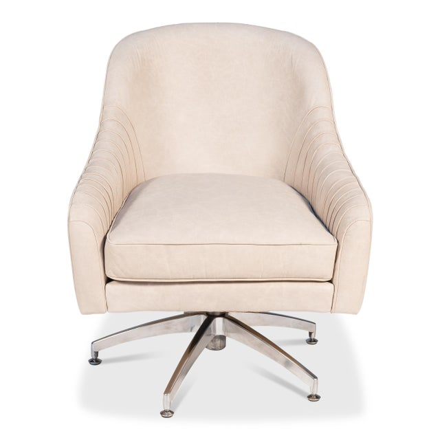 This is a great looking leather chair and very comfortable. The inside arms have sewn down and top-stitched pleats, an...