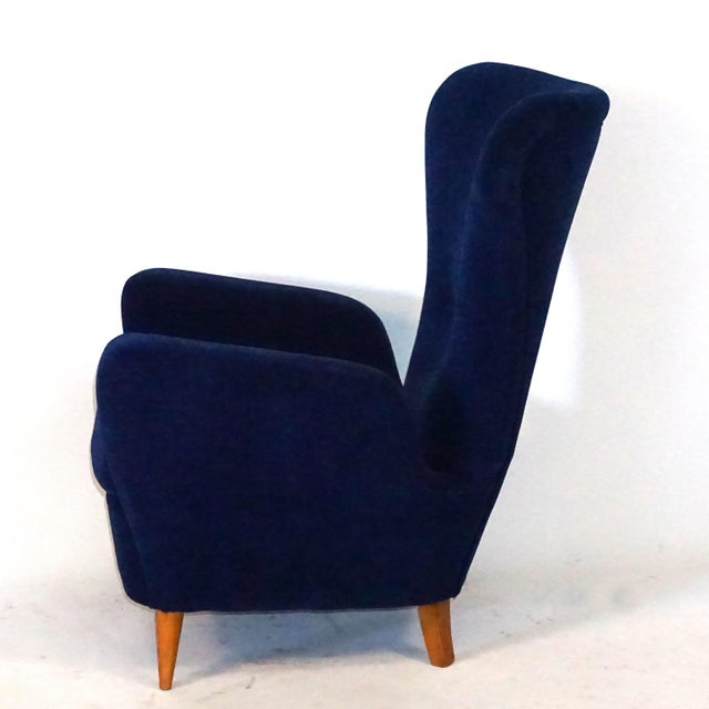 A very elegant pair of Paolo Buffa lounge chairs tapered walnut legs with dark blue velvet upholstery. Paolo Buffa's...
