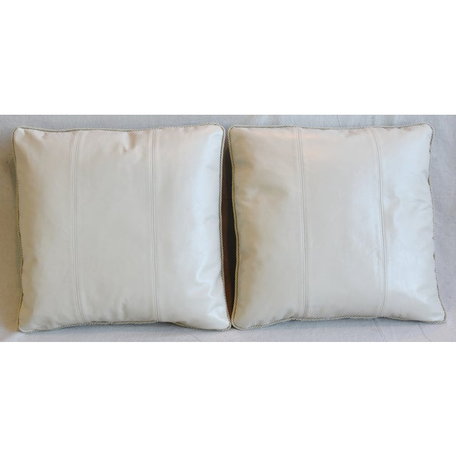 Pair of large reversible custom tailored pillows in unused Italian Spinneybeck tanned cowhide leather. The leather comes...