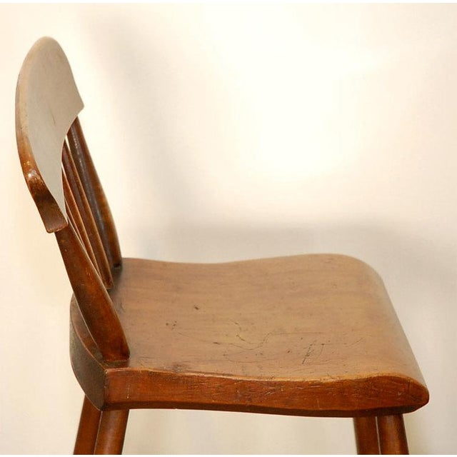 This is a well made chair for a higher clerks desk. It would look good in that period setting. United States, circa 1900's...