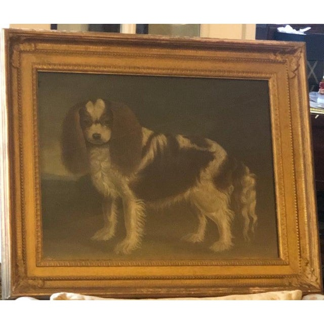 The Cavalier King Charles facing the viewer set in a landscape. The piece was made in the late 20th century.