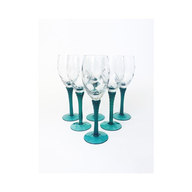 A beautiful set of 6 Mid Century champagne glasses. Perfect for a champagne toast or for serving a glass of wine. Green...