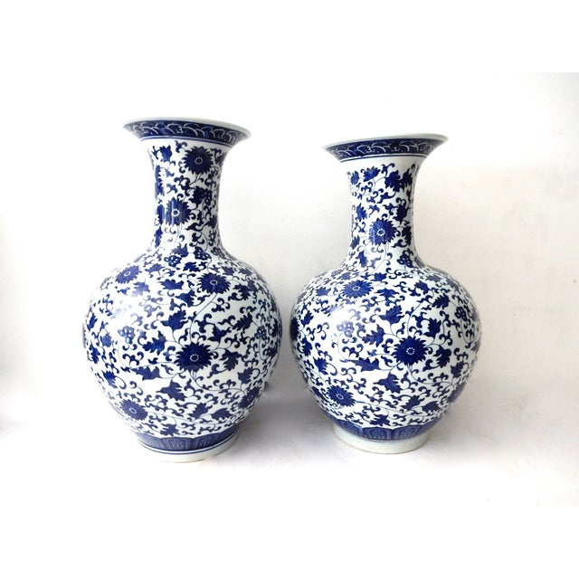 Stunning onion-shaped pair of Chinese porcelain blue-and-white vases decorated with Chrysanthemum flowers. This pair would...