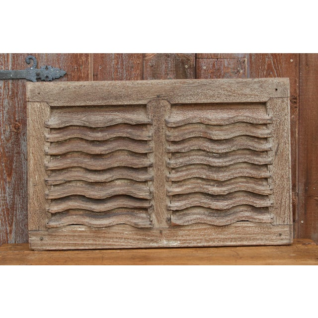 Antique rustic and primitive shutter ventilator window panel, retains its original aged patina finish with a painted...
