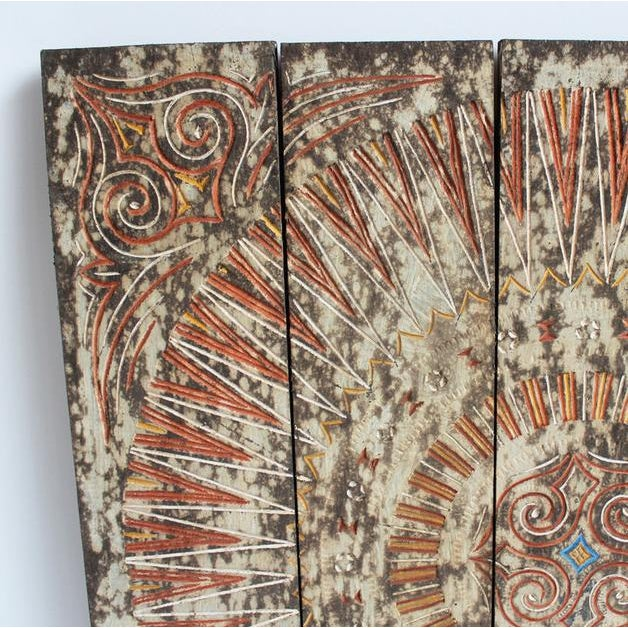 Original carved wood Asmat tribal panel. Interesting carved designs. Wonderful wall art piece.