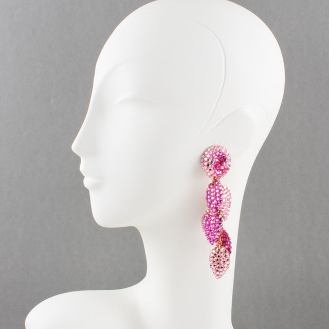 Statement clip-on earrings designed by Richard Kerr in the 1980s. They are made up of his signature pave rhinestones....