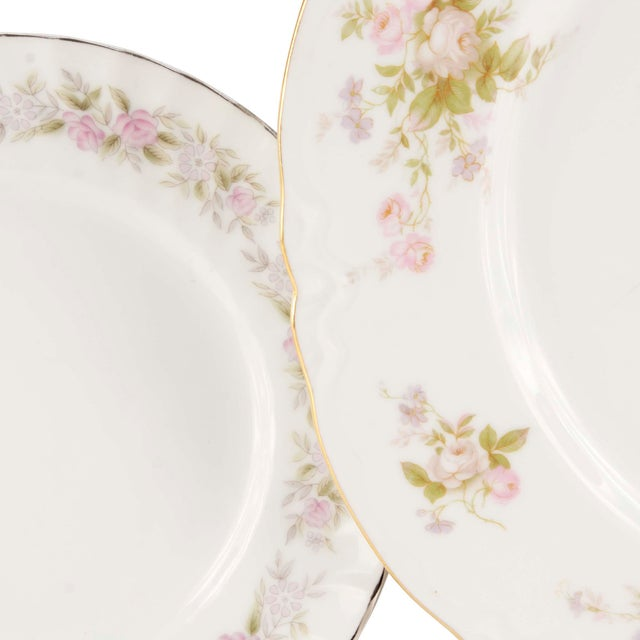 In perfect condition is this set of fine china made in Japan, discontinued by the 70s, rimmed in platinum with a delicate...