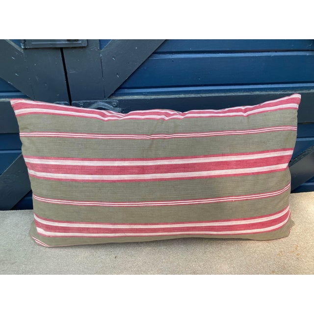 A pillow made from a circa 1880's stripe cotton in lovely mellowed shades of red and brown. A down insert is included.