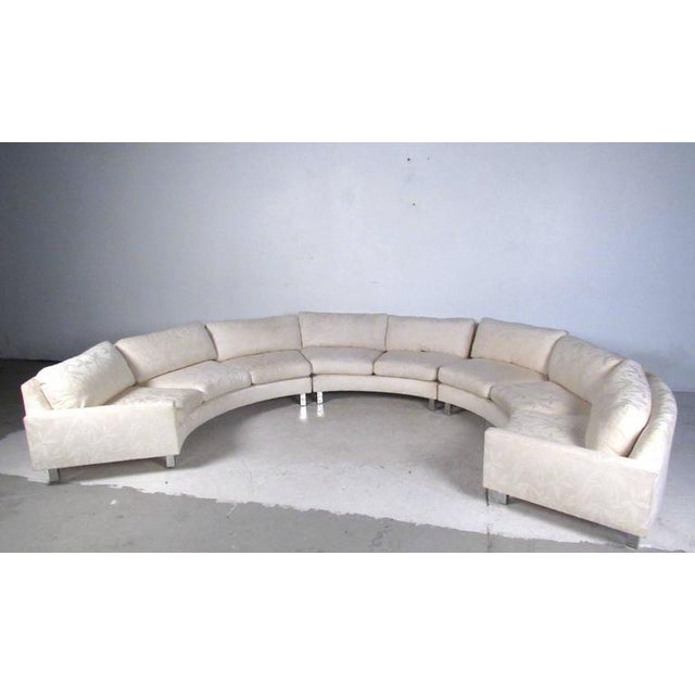This large three-piece circular sofa offers plenty of seating for any interior. Comfortable down upholstery, unique chrome...