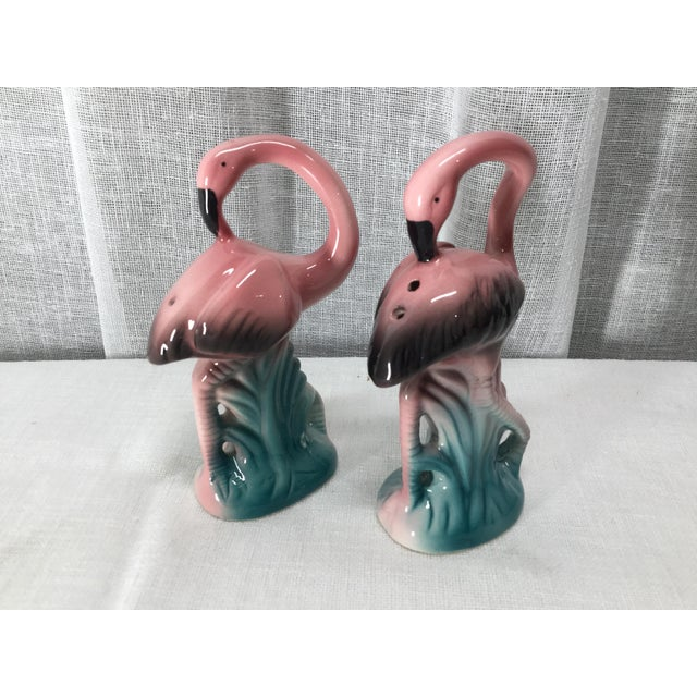 Delightful pink and turquoise flamingos will be a fun addition to your home. Salt and pepper will become a conversational...