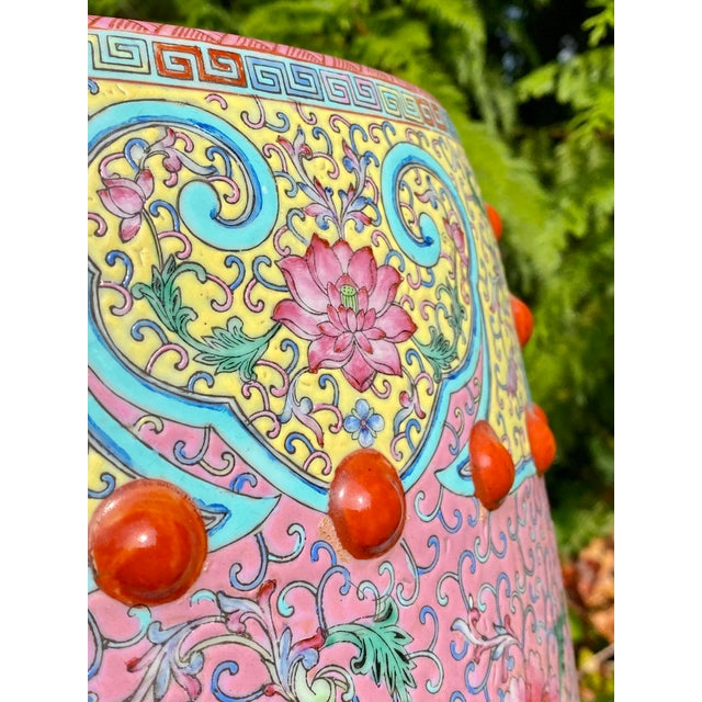 Famille rose bright colorful vintage garden seat, stool or occasional side table. It features a round and oblong body with...