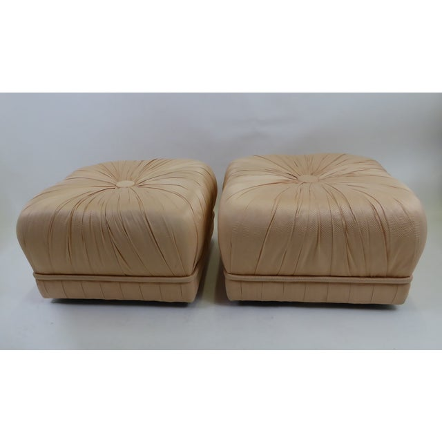 REDUCED FROM $2250...... Glamorous and luxe, this pair of Hollywood inspired poufs is dramatic with their heavily pleated...