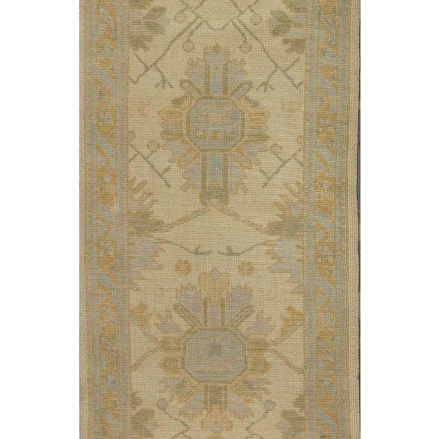 This beautiful rug is hand made, 100% wool pile, made in Turkey, Oushak region. It features a pattern in a vibrant...
