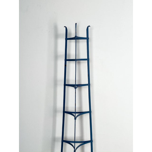 A mid 19th Century American blue painted iron plate rack or pie cooling rack, circa 1860