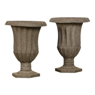 A pair of zinc urns from France For Sale