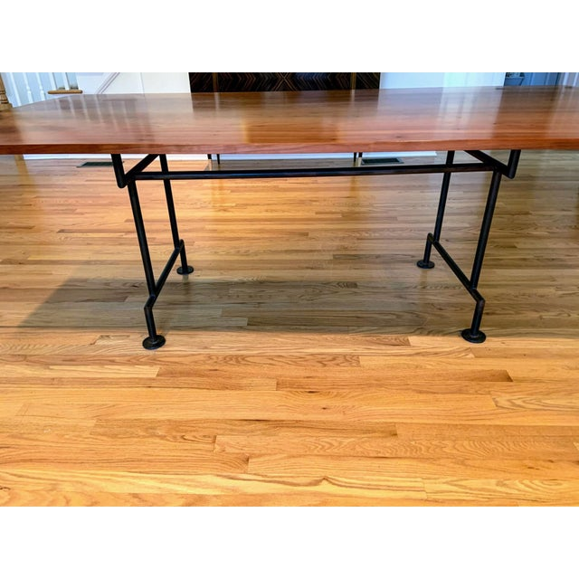 A large custom industrial style dining table. The top is in mint condition. The heavy base is very sturdy. This style of...