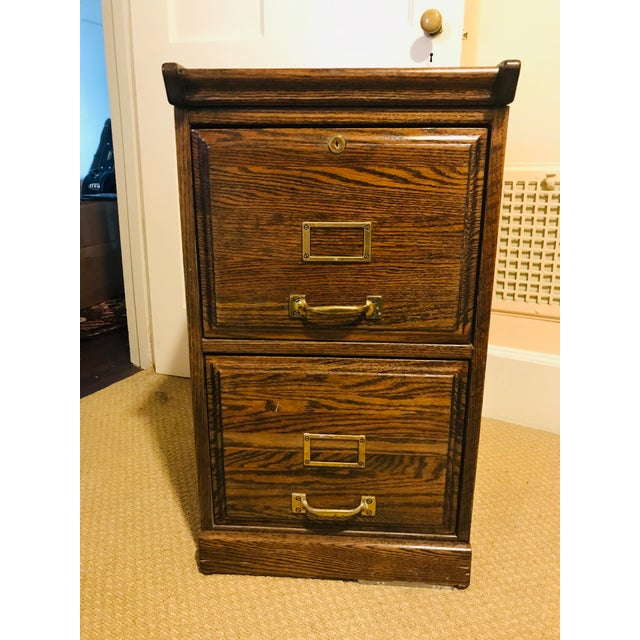 Very nice (and very heavy!!) two-drawer solid oak file cabinet with bronze hardware & raised side panels as well as a...