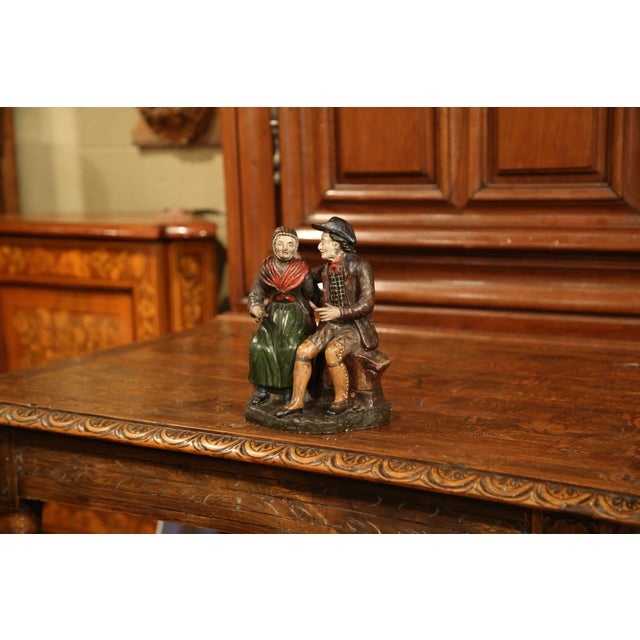 Place this antique colorful terracotta sculpture on a shelf in your family room; crafted circa 1920, the ceramic piece...