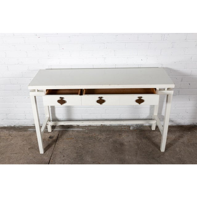 White painted vanity with 2 drawers and brass hardware.