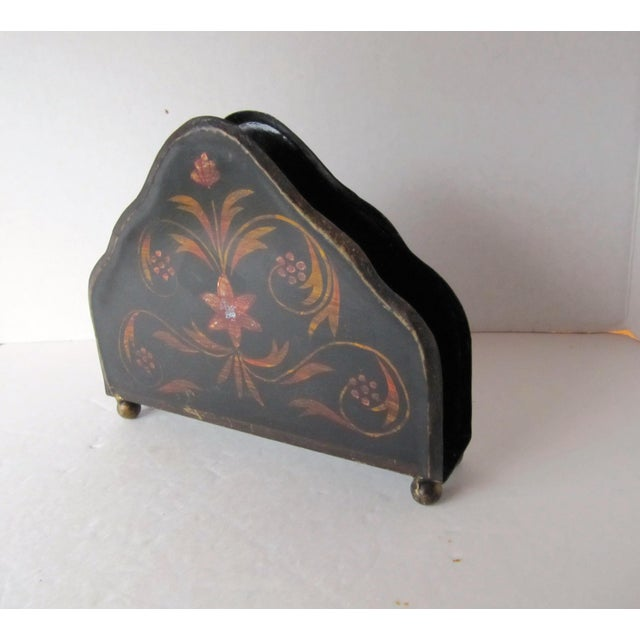 Vintage black tole letter holder with flower and swirl accents.