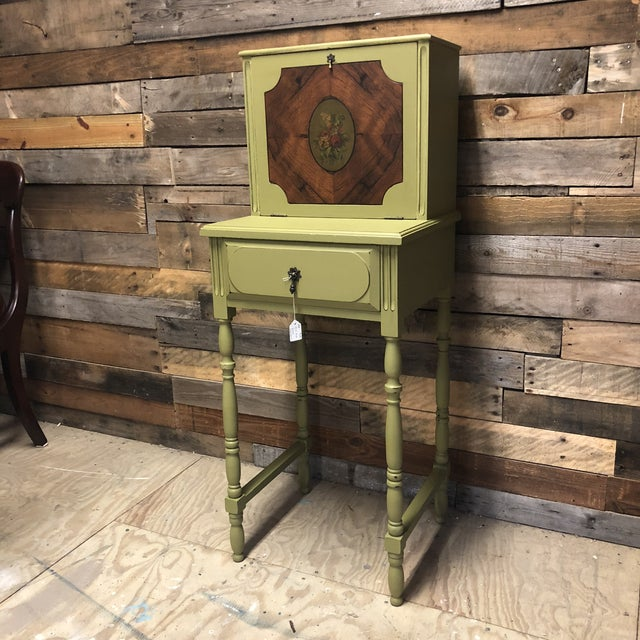 Small antique ladies desk by Johnson Handley Johnson. Updated in mossy green and soft yellow. Drop front with cubbies...