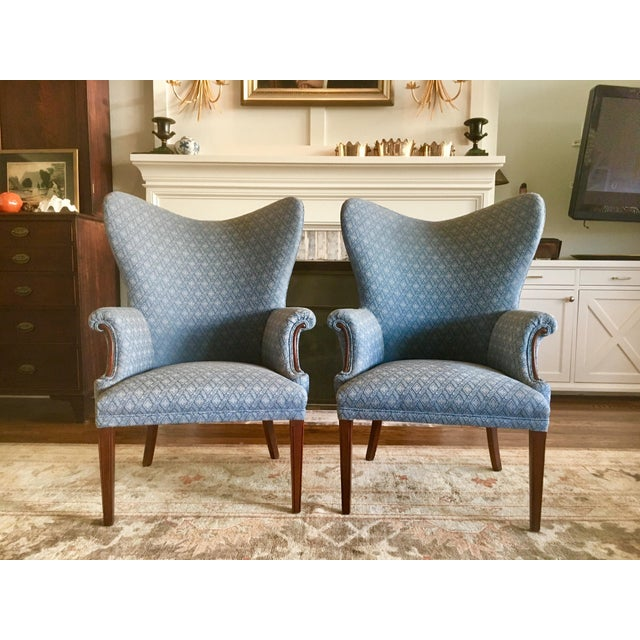 Amazing pair of 1940s Butterfly Wingback Chairs. Feature a wide dramatic back, and fluted detailing to the legs The...