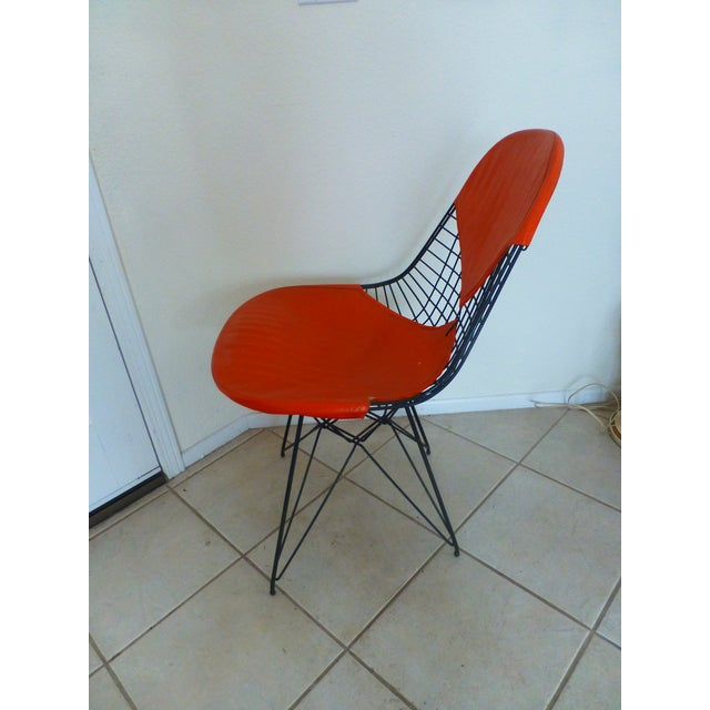 Purchased more than a decade ago at a MidCentury Estate. this vintage Orange Bikini wire chair has been treated like the...