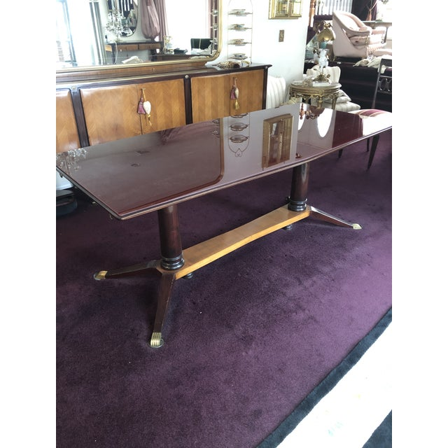 Dinning room glass top inlaid table with extension. Made in the 1950s.