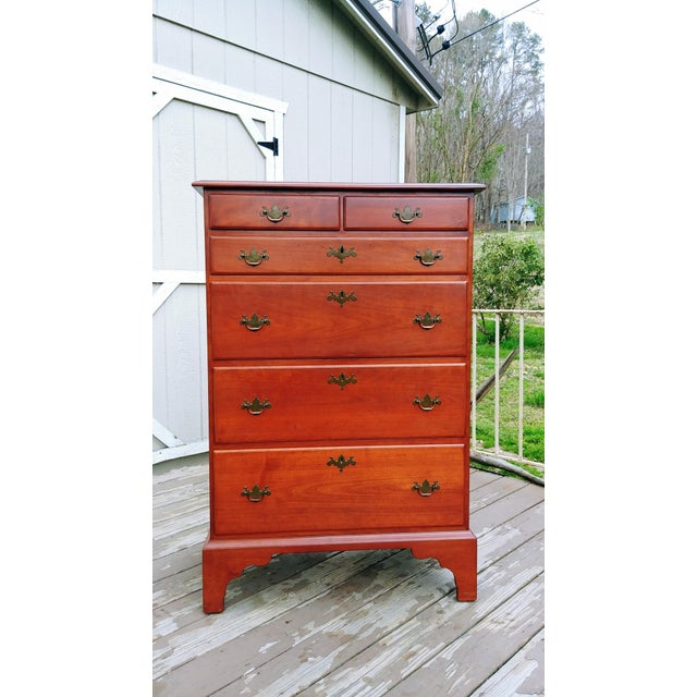 Item offered is a quality beautiful traditional Virginia Craftsmen Reproduction solid Cherry 6 drawer chest of drawers. It...