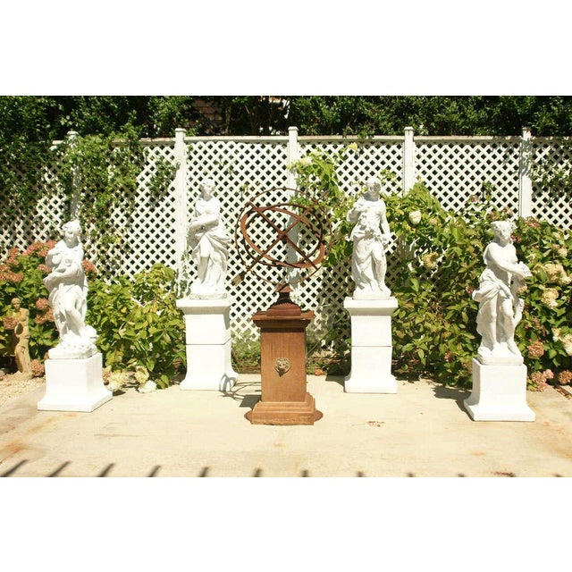 The four seasons, a set of 4 garden statues done in white chalk on white chalk plinths. There are 4 statues and 6 plinths....