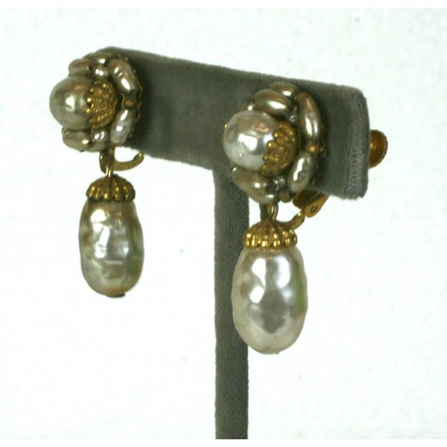 Miriam Haskell signature Russian Gilt filigree drop earrings, set with classic hand made faux round, oval and rice pearls....